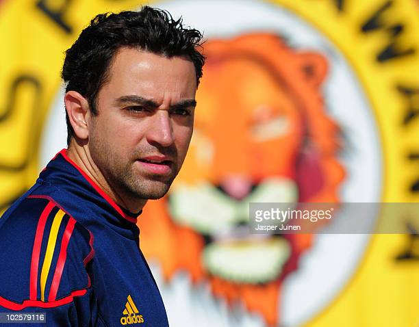 Xavi Hernandez of Spain looks on as he walks back to the team hotel after a training session, ahead of their World Cup 2010 Quarter-Final match...