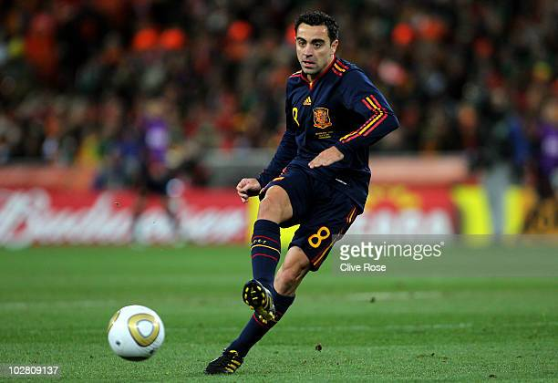 Xavi Hernandez of Spain passes the ball during the 2010 FIFA World Cup South Africa Final match between Netherlands and Spain at Soccer City Stadium...