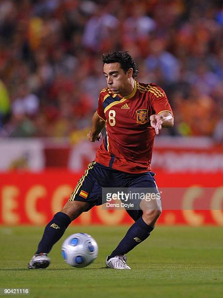 Xavi Hernandez of Spain passes the ball during the Group 5 FIFA2010 World Cup Qualifier match between Spain and Belgium at the Riazor stadium on...