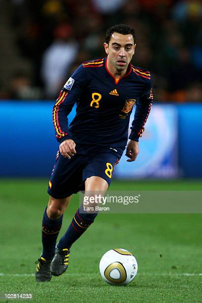 Xavi Hernandez of Spain runs with the ball during the 2010 FIFA World Cup South Africa Final match between Netherlands and Spain at Soccer City...