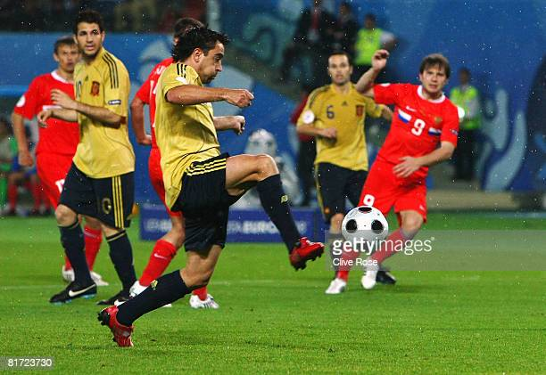 Xavi Hernandez of Spain scores the opening goal during the UEFA EURO 2008 Semi Final match between Russia and Spain at Ernst Happel Stadion on June...