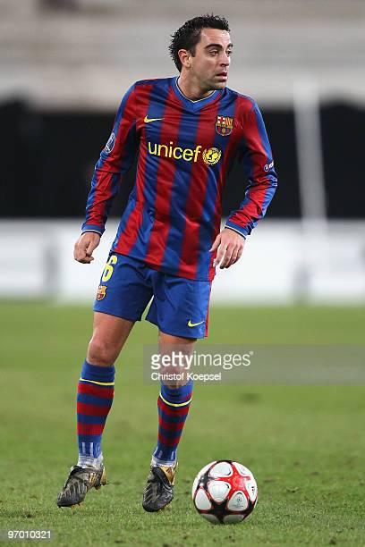 Xavi Hérnandez of Barcelona runs with the ball during the UEFA Champions League round of sixteen first leg match between VfB Stuttgart and FC...