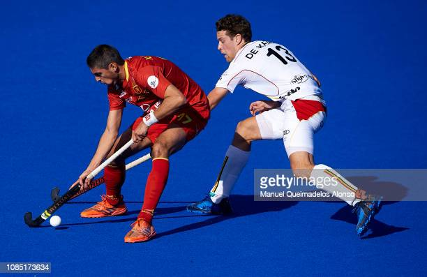 Xavi Lleonart of Spain competes for the ball with Nicolas de Kerpel of Belgium during the Men's FIH Field Hockey Pro League match between Spain and...