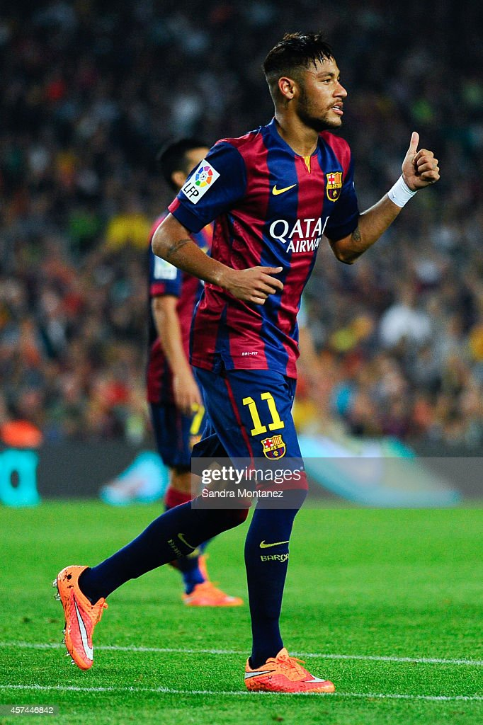 Xavi Neymar of FC Barcelona gives a thumbs up during the La Liga match between FC Barcelona and SD Eibar at Camp Nou on October 18, 2014 in Barcelona, Spain.
