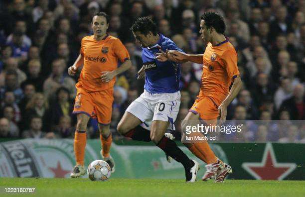 Xavi of Barcelona ivies with Nacho Novo of Rangers during the UEFA Champions League, Group E match between Rangers and Barcelona at Ibrox Stadium on...