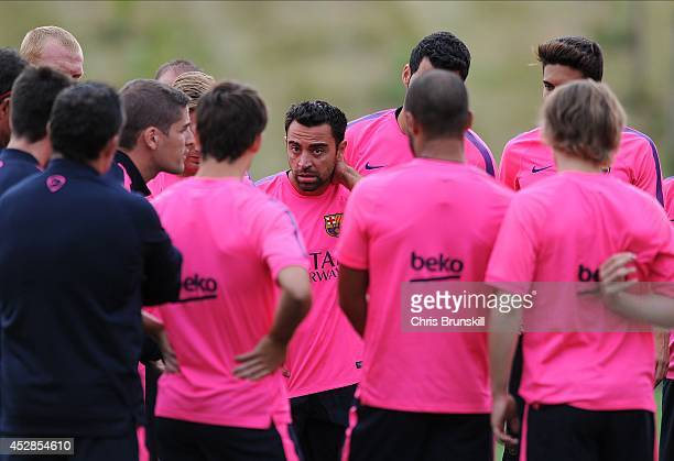 Xavi of Barcelona looks on during the Barcelona Training Session at St George's Park on July 28, 2014 in Burton-upon-Trent, England.