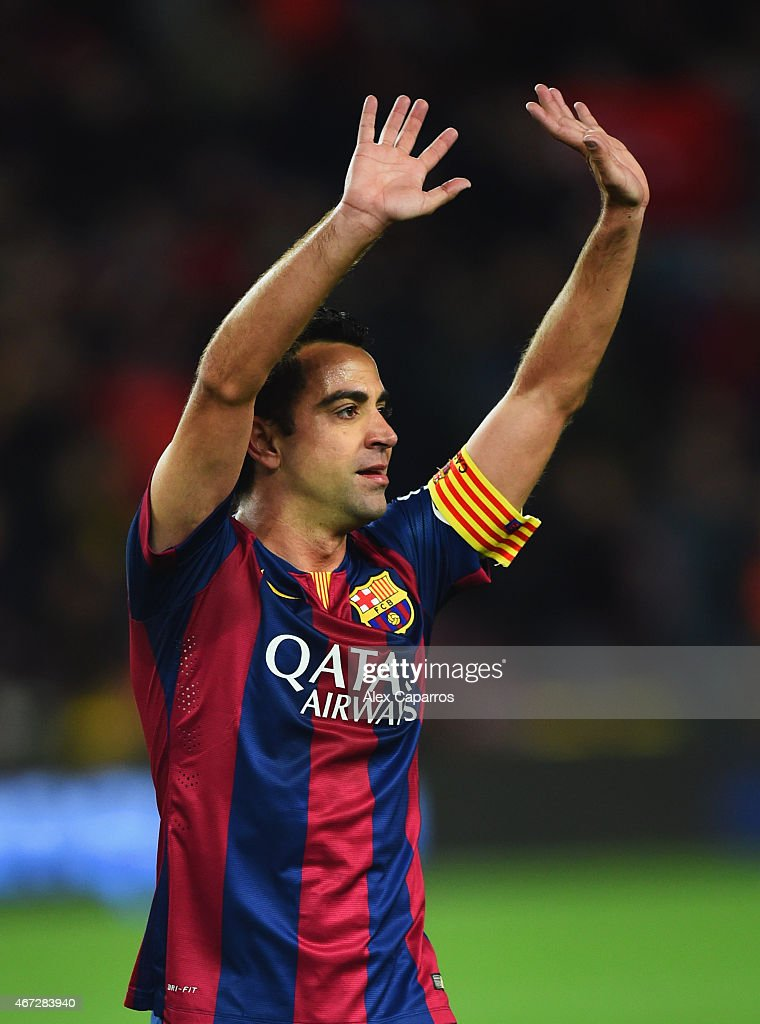 Xavi of Barcelona salutes the crowd after victory in the La Liga match between FC Barcelona and Real Madrid CF at Camp Nou on March 22, 2015 in Barcelona, Spain.