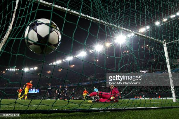 Xavi of Barcelona takes and scores a penalty for his teams second goal past goal keeper Salvatore Sirigu of PSG during the UEFA Champions League...