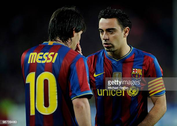 Xavi of Barcelona talks to team mate Lionel Messi during the UEFA Champions League Semi Final Second Leg match between Barcelona and Inter Milan at...