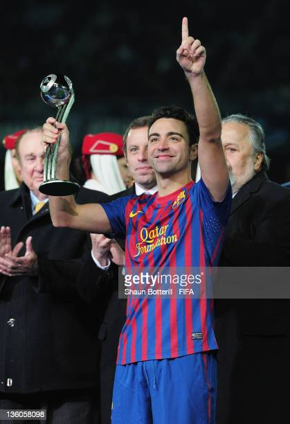 Xavi of Barcelona with the Adidas Silver Ball Award after the FIFA Club World Cup Final match between Santos and Barcelona at the Yokohama...