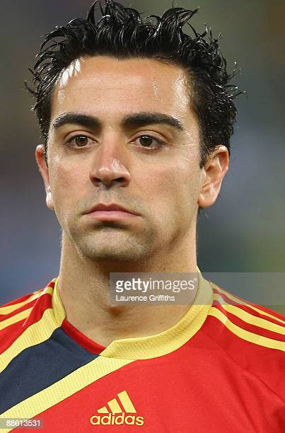 Xavi of Spain lines up for the National Anthem during the FIFA Confederations Cup match between Spain and South Africa at Free State Stadium on June...