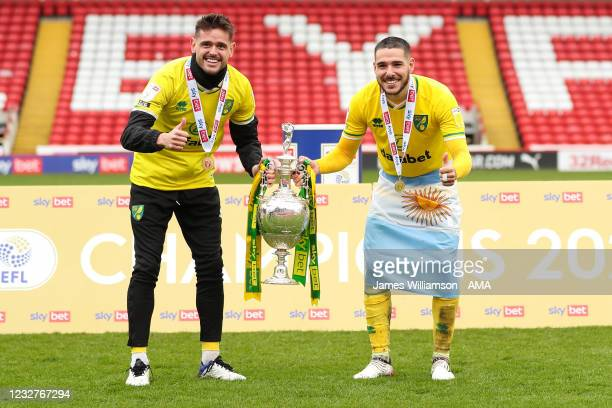 Xavi Quintilla and Emi Buendia of Norwich City with the Sky Bet Championship trophy during the Sky Bet Championship match between Barnsley and...