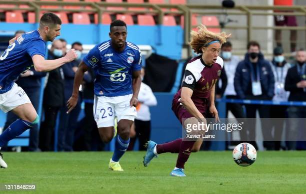 Xavi Simons of Paris Saint-Germain in action during the Ligue 1 match between Strasbourg and Paris at Stade de la Meinau on April 10, 2021 in...
