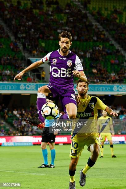 Xavi Torres of the Glory controls the ball against Danny De Silva of the Mariners during the round 22 ALeague match between the Perth Glory and the...
