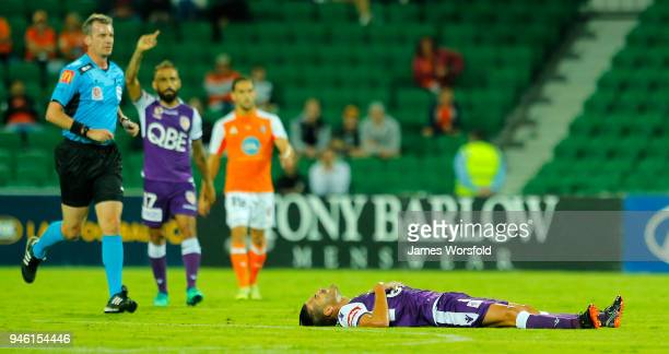 Xavi Torres of the Perth Glory lays on the ground after injuring his hamstring during the round 27 ALeague match between the Perth Glory and the...