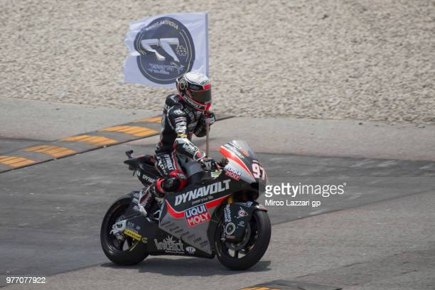 Xavi Vierge of Spain and Dynavolt Intact GP remembers Andreas Perez of Spain with flag at the end of the Moto2 race during the MotoGp of Catalunya...