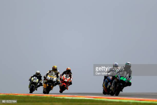 Xavi Vierge of Spain and Tech 3 Racing and Luca Marini of Italy and the Forward Racing Team ride during Moto2 practice ahead of the MotoGP of Aragon...
