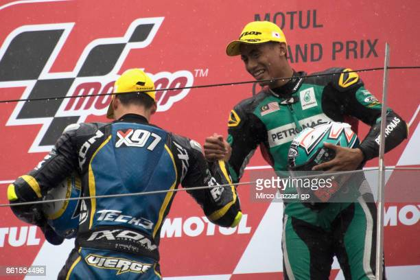 Xavi Vierge of Spain and Tech3 Racing and Hafizh Syahrin of Malaysia and Petronas Raceline Malaysia celebrate on the podium at the end of the Moto2...
