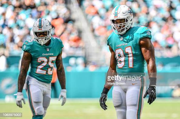 Xavien Howard And Cameron Wake Of The Miami Dolphins In Action