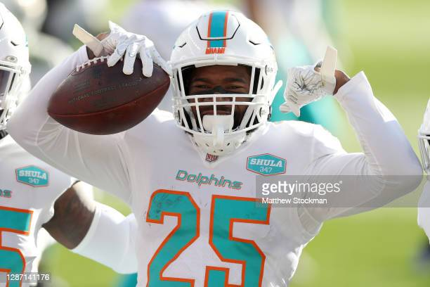 Xavien Howard of the Miami Dolphins celebrates his interception during the first quarter against the Denver Broncos at Empower Field At Mile High on...