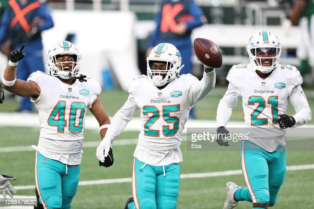 Xavien Howard of the Miami Dolphins celebrates with teammates after a interception against the New York Jets during their NFL game at MetLife Stadium...