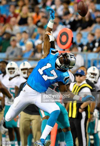 Xavien Howard of the Miami Dolphins defends a pass to Devin Funchess of the Carolina Panthers in the second quarter during the game at Bank of...