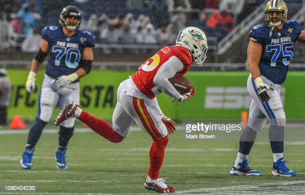 Xavien Howard of the Miami Dolphins makes an interception in the fourth quarter during the 2019 NFL Pro Bowl at Camping World Stadium on January 27...