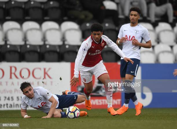 Xavier Amaechi of Arsenal skips past Anthony Georgiou of Tottenham during the match between Arsenal and Tottenham Hotspur at Meadow Park on March 10...