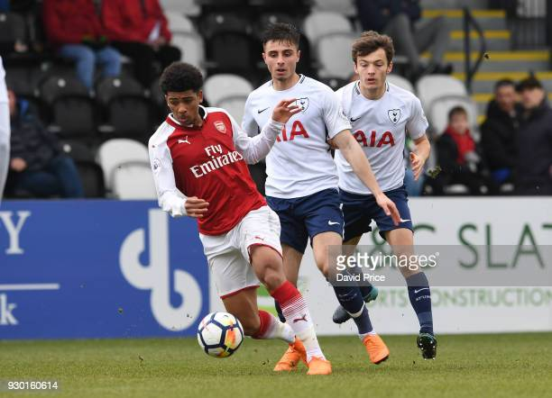 Xavier Amaechi of Arsenal takes on Anthony Georgiou and George Marsh of Tottenham during the match between Arsenal and Tottenham Hotspur at Meadow...