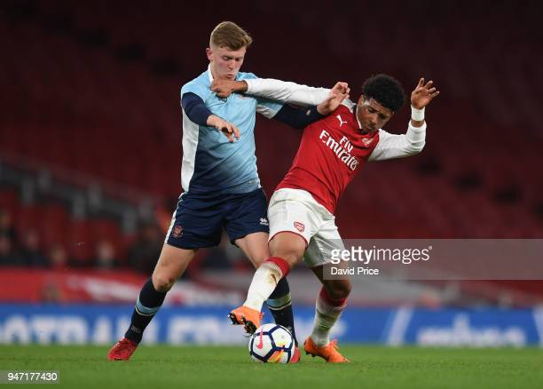 Xavier Amaechi of Arsenal takes on Rowan Roache of Blackpool during the match between Arsenal and Blackpool at Emirates Stadium on April 16 2018 in...