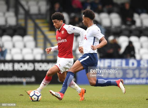 Xavier Amaechi of Arsenal takes on Tashan OakleyBoothe of Tottenham during the match between Arsenal and Tottenham Hotspur at Meadow Park on March 10...
