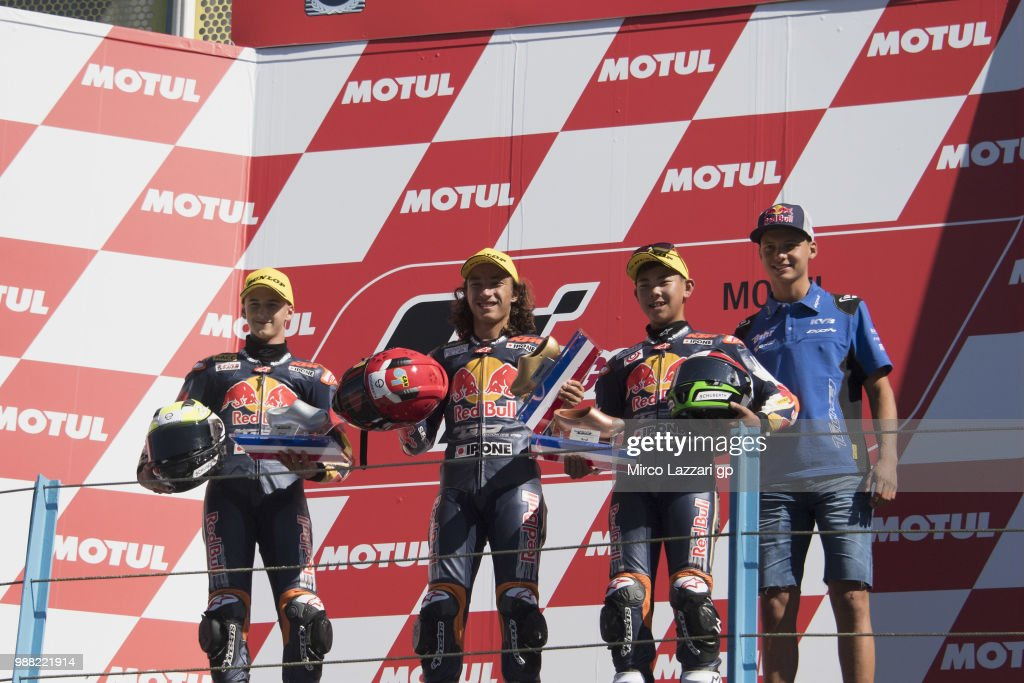 Xavier Artigas of Spain, Can Oncu of Turkie and Ryusei Yamanaka of Japan and Bo Bendsneyder of Dutch and Tech3 Racing celebrate on the podium at the end of the Red Bull MotoGP Rookies Cup during the MotoGP Netherlands - Qualifying on June 30, 2018 in Assen, Netherlands.