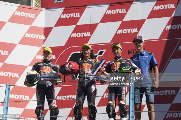Xavier Artigas of Spain Can Oncu of Turkie and Ryusei Yamanaka of Japan and Bo Bendsneyder of Dutch and Tech3 Racing celebrate on the podium at the...