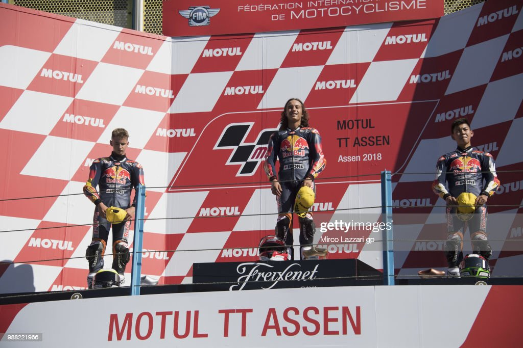 Xavier Artigas of Spain, Can Oncu of Turkie and Ryusei Yamanaka of Japan celebrate on the podium at the end of the Red Bull MotoGP Rookies Cup during the MotoGP Netherlands - Qualifying on June 30, 2018 in Assen, Netherlands.