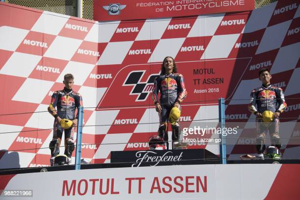 Xavier Artigas of Spain Can Oncu of Turkie and Ryusei Yamanaka of Japan celebrate on the podium at the end of the Red Bull MotoGP Rookies Cup during...