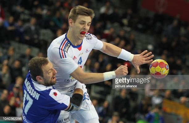 Xavier Barachet of France is blocked by Sverre Jakobsson of Iceland during the men's Handball World Championships round of 16 match France vs Iceland...