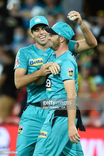 Xavier Bartlett and Mark Steketee of the Heat celebrate a wicket during the Big Bash League match between the Brisbane Heat and the Melbourne Stars...