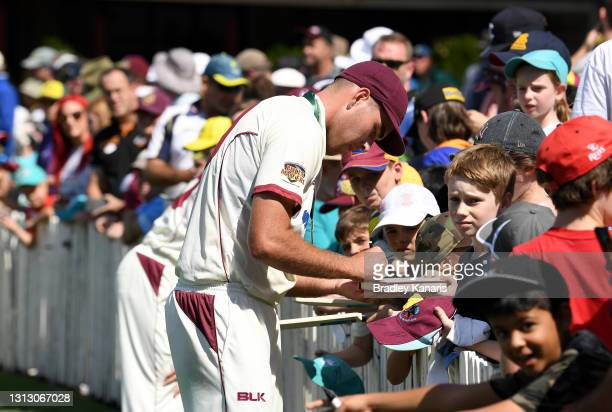 Xavier Bartlett of Queensland signs autographs for the fans during day four of the Sheffield Shield Final match between Queensland and New South...