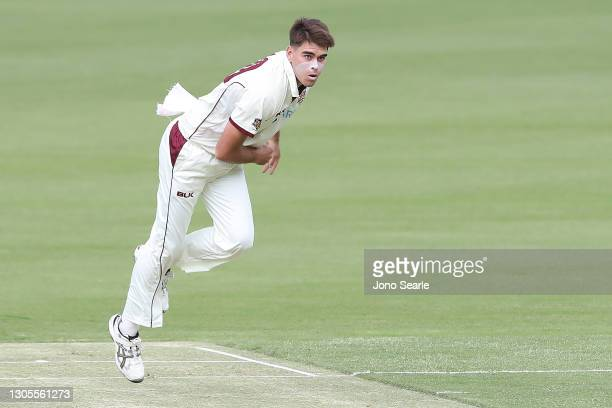 Xavier Bartlett of the Bulls bowls during day one of the Sheffield Shield match between Queensland and Western Australia at The Gabba on March 06,...