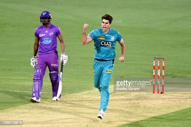 Xavier Bartlett of the Heat celebrates taking the wicket of Tim David of the Hurricanes during the Big Bash League match between the Hobart...