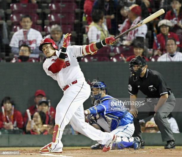 Xavier Batista of the Hiroshima Carp hits an RBI double in the first inning against the DeNA BayStars in Game 5 of the Central League Climax Series...