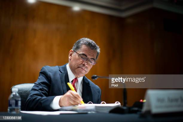 Xavier Becerra, Secretary of Health and Human Services , takes notes during a Senate Appropriations Subcommittee hearing on June 9, 2021 at the U.S....