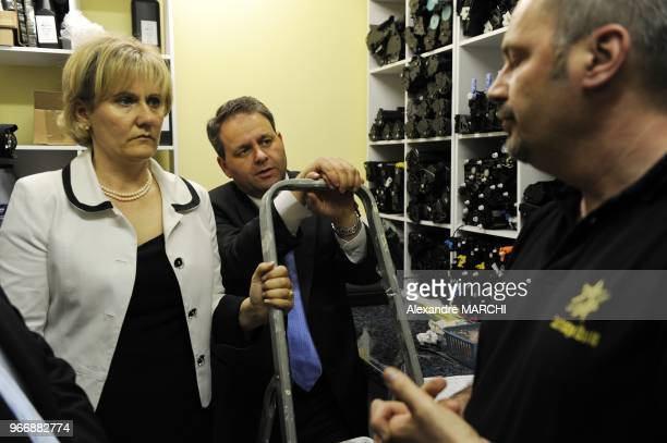 Xavier Bertrand General Secretary of the political party UMP and French junior minister for Family Nadine Morano visits the Cartridge World company
