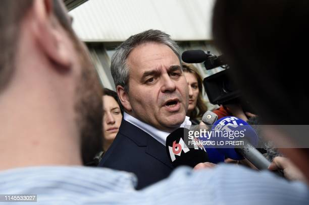 Xavier Bertrand president of the regional council of Hauts de France answers journalists' questions as he meets employees of SaintSaulve former...