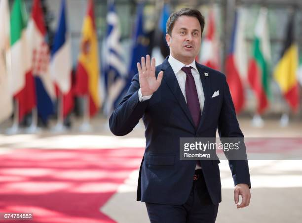 Xavier Bettel Luxembourg's prime minister waves as he arrives for a European Union leaders emergency Brexit summit at the Europa building in Brussels...