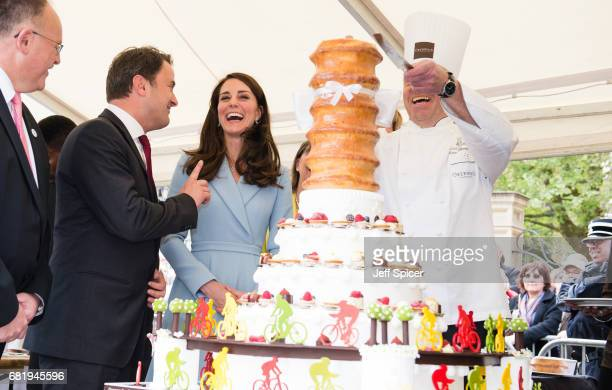 Xavier Bettel Prime Minister of Luxembourg and Catherine Duchess of Cambridge view a cake with a cycling design as they tour a cycling themed...