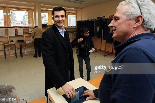 Xavier Bonnefont French rightwing opposition Union for a Popular Movement candidate for the mayoral election in Angouleme casts his ballot to vote in...