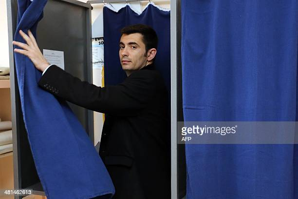 Xavier Bonnefont French rightwing opposition Union for a Popular Movement candidate for the mayoral election in Angouleme steps out of a polling...