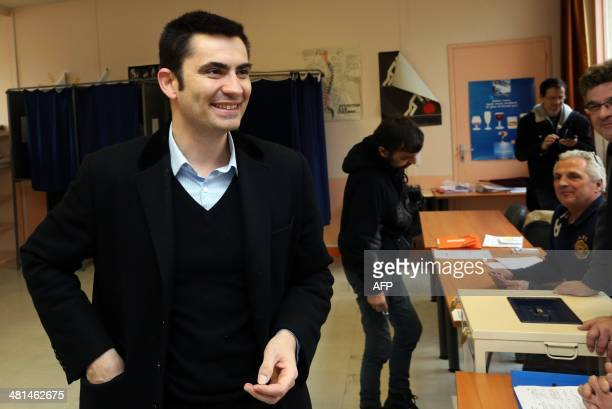 Xavier Bonnefont French rightwing opposition Union for a Popular Movement candidate for the mayoral election in Angouleme smiles after voting in the...