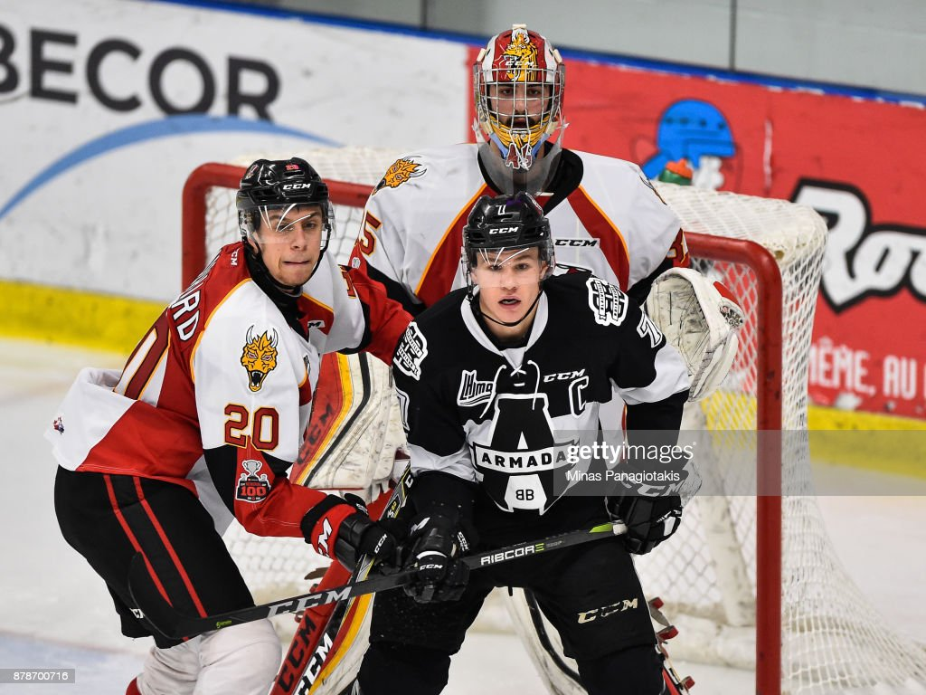 Xavier Bouchard #20 of the Baie-Comeau Drakkar and Alexandre Alain #7 of the Blainville-Boisbriand Armada battle for position in front of goaltender Antoine Samuel #35 during the QMJHL game at Centre d'Excellence Sports Rousseau on November 24, 2017 in Boisbriand, Quebec, Canada. The Blainville-Boisbriand Armada defeated the Baie-Comeau Drakkar 5-3.